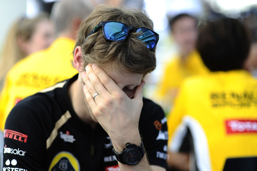 Romain Grosjean cuts a tired figure in the paddock