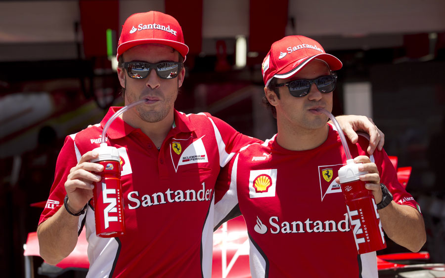 Fernando Alonso and Felipe Massa pose for sponsor photos