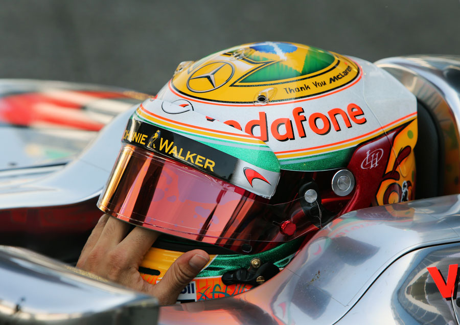 Lewis Hamilton in the cockpit of his MP4-27 with a 'Thank You' message for McLaren on his helmet