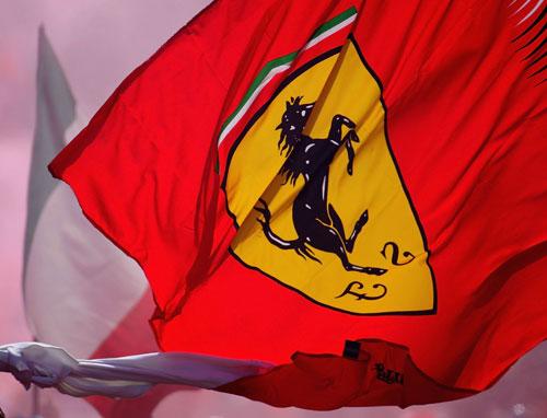 A fan waves a Ferrari flag