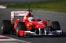Fernando Alonso checks his mirrors