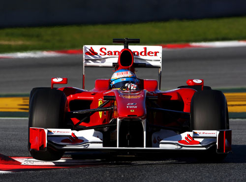 Fernando Alonso blasts through the final chicane