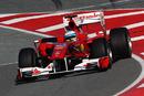 Fernando Alonso dives into the pit lane