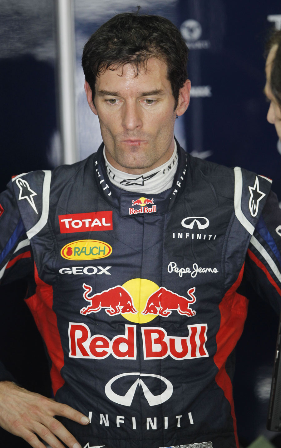 Mark Webber deep in thought in the Red Bull garage