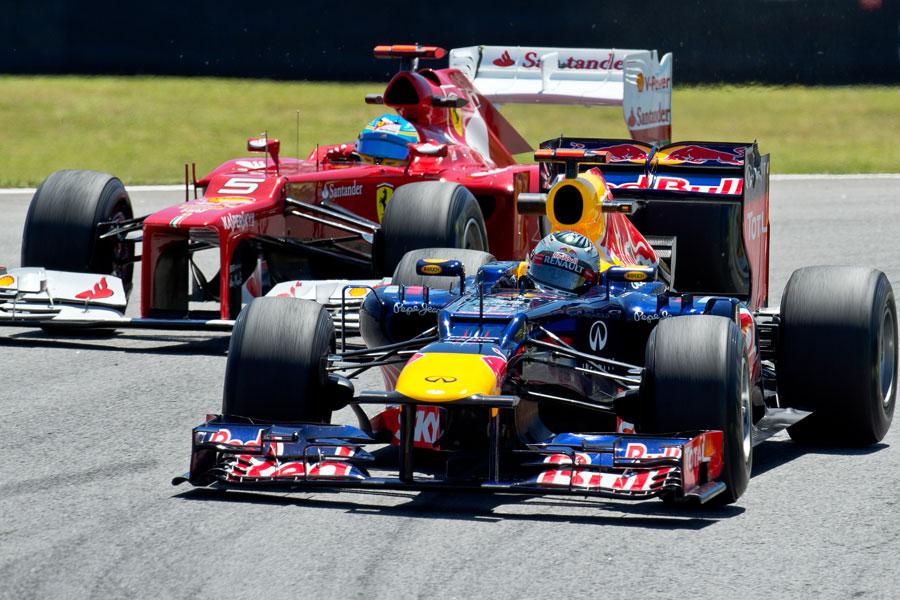 Sebastian Vettel overtakes Fernando Alonso during FP2