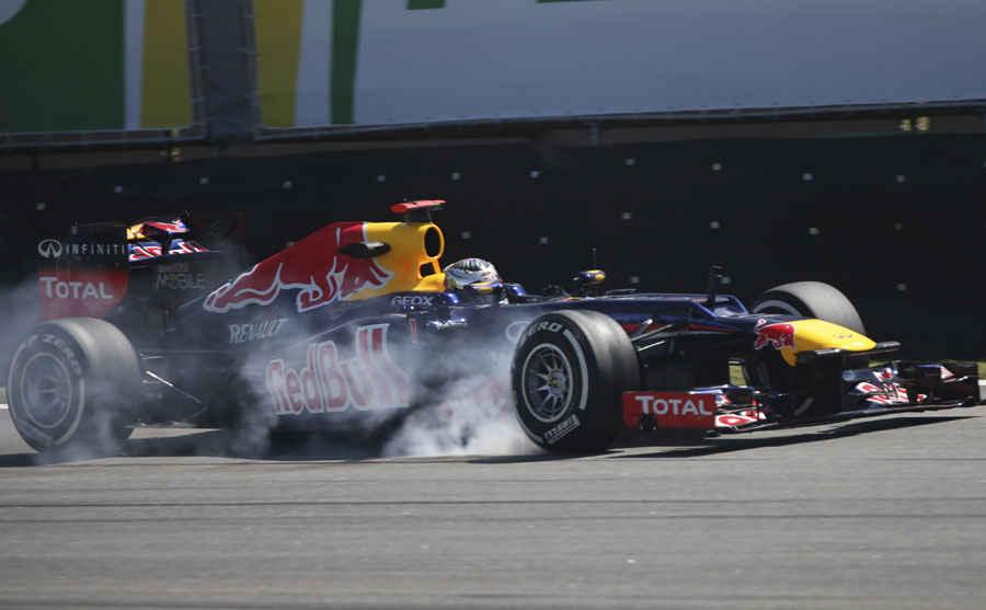 Sebastian Vettel locks up on the medium tyres