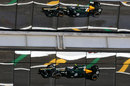 Vitaly Petrov reflected in the hospitality units above the finish line
