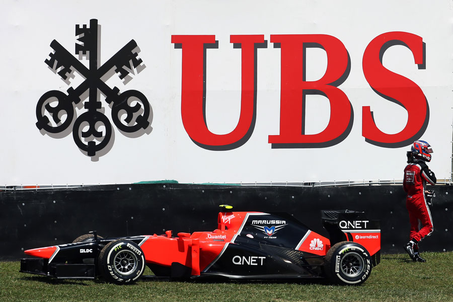 Charles Pic walks away from his stricken Marussia