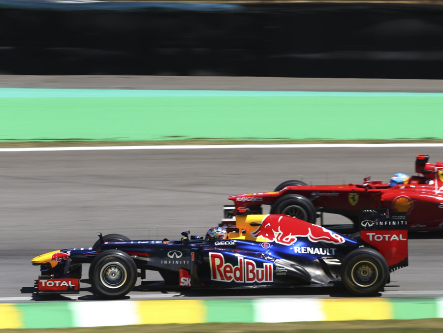 Sebastian Vettel passes Fernando Alonso on track