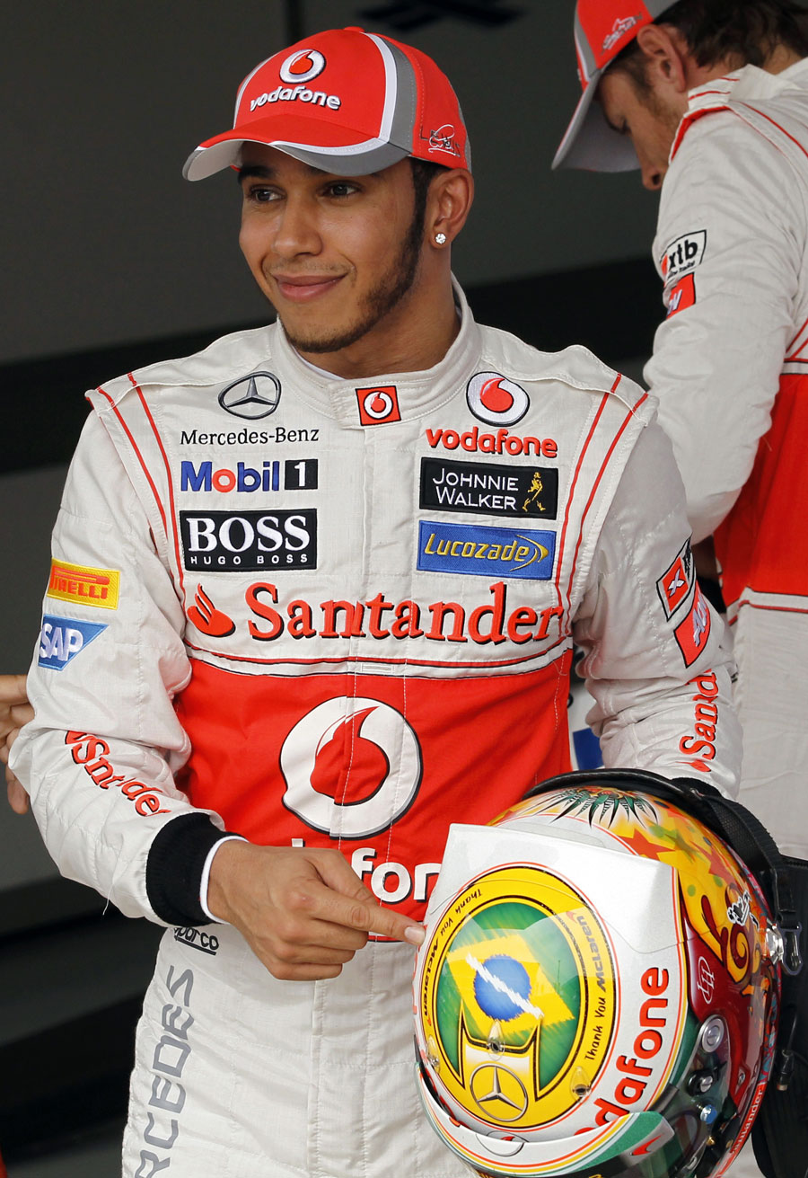 Lewis Hamilton points to the message to McLaren on his helmet after qualifying