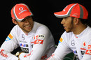 Jenson Button and Lewis Hamilton share a joke in the post-race press conference