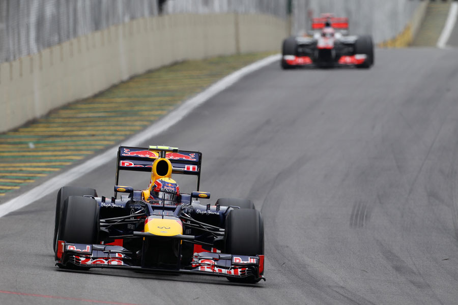 Mark Webber leads Jenson Button in to turn one