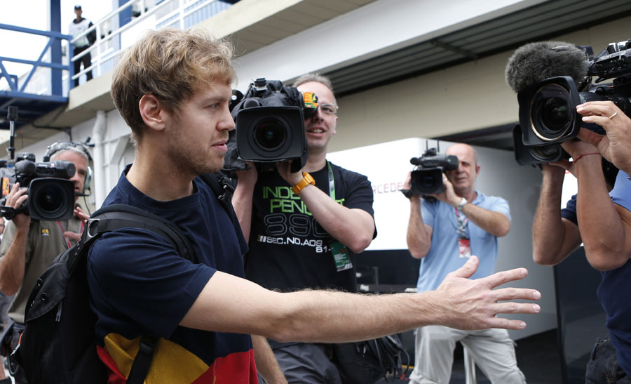Sebastian Vettel arrives for the season finale