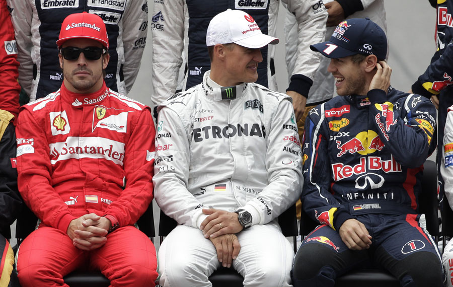 Fernando Alonso, Michael Schumacher and Sebastian Vettel at the drivers' photo ahead of the race