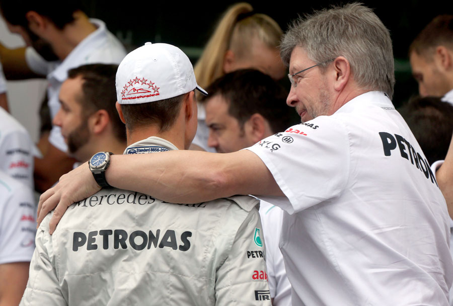 Thanks and goodbye ... Ross Brawn puts an arm round Michael Schumacher