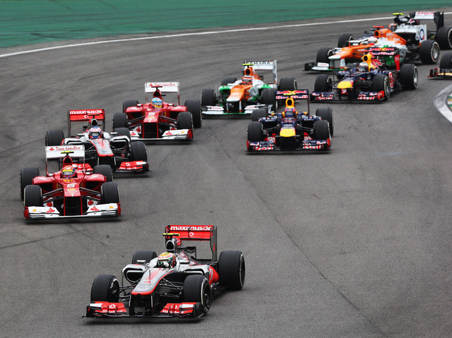 Lewis Hamilton leads the pack through turn one as Sebastian Vettel loses ground at the start