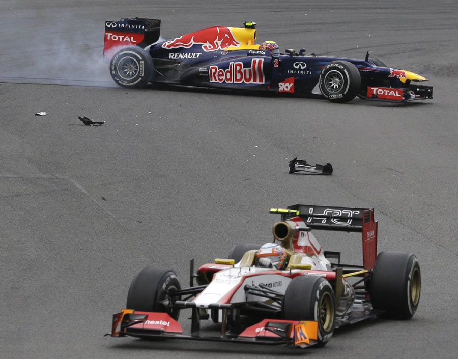Mark Webber fights to regain control