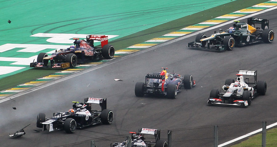 Sebastian Vettel ends up going backwards after colliding with Bruno Senna  at the start