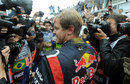 Sebastian Vettel is met by a bank of photographers after winning his third world title