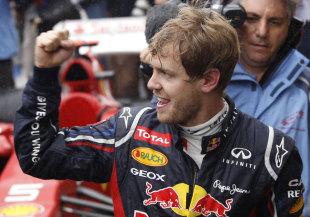 Sebastian Vettel celebrates his third world title after finishing sixth in the Brazilian Grand Prix