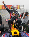Sebastian Vettel celebrates his third world title