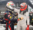 The king is dead ... Sebastian Vettel is congratulated by Michael Schumacher