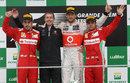 Jenson Button takes the plaudits flanked by a brace of Ferrari drivers