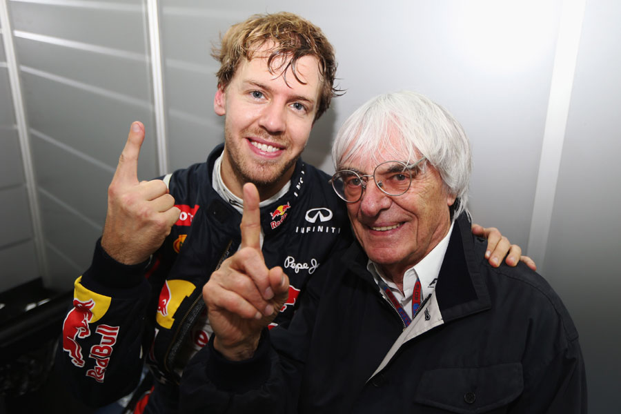 Sebastian Vettel celebrates his third world title with Bernie Ecclestone