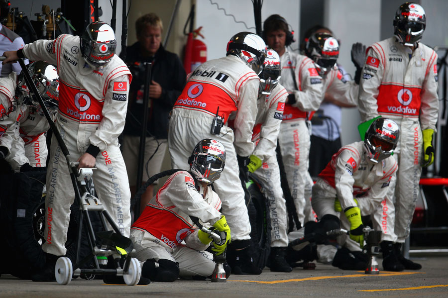 The McLaren team prepares for a pit stop