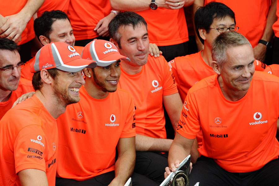 Jenson Button celebrates his victory with Lewis Hamilton and Martin Whitmarsh