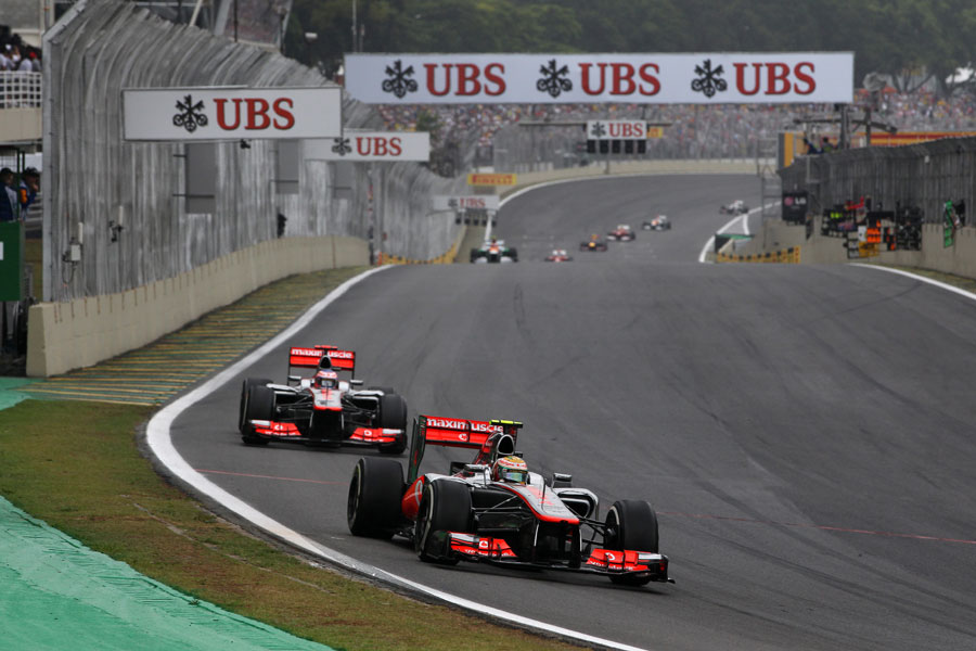 Lewis Hamilton leads Jenson Button in to turn one