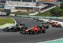 Vitaly Petrov and Timo Glock go wheel to wheel