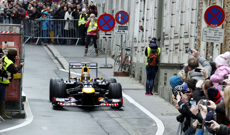 Sebastian Vettel displays his RB8 for fans in Graz