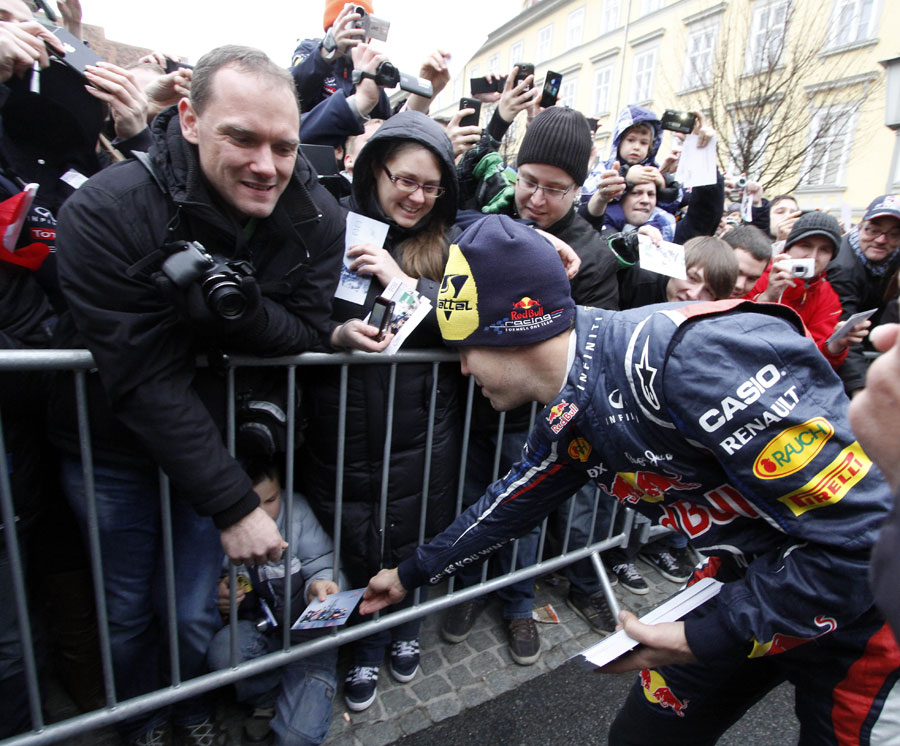 Sebastian Vettel signs autographs after a showrun in Graz
