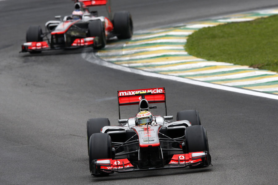 Lewis Hamilton leads Jenson Button through the Senna S