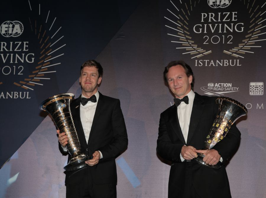 Sebastian Vettel and Christian Horner receive their awards at the FIA prize-giving gala
