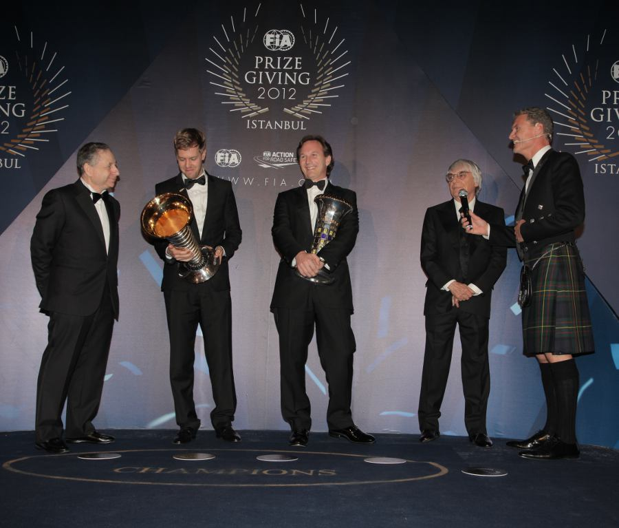 Sebastian Vettel and Christian Horner receive their awards at the FIA prize-giving gala alongside Jean Todt, Bernie Ecclestone and David Coulthard