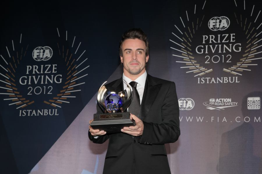 Fernando Alonso receives his award for second place in the drivers' championship at the FIA prize-giving gala