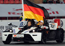 Sebastian Vettel and Michael Schumacher drive a victory lap at the Race of Champions