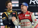 Romain Grosjean celebrates on the podium after beating Tom Kristensen in the Champion of Champions event at the Race of Champions