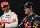 Lewis Hamilton cracks a smile at Sebastian Vettel during the post-qualifying press conference