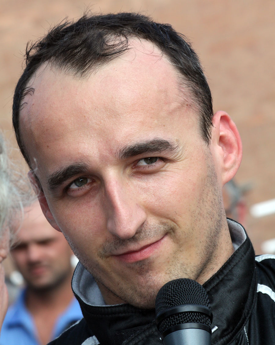 Robert Kubica celebrates his victory on the podium