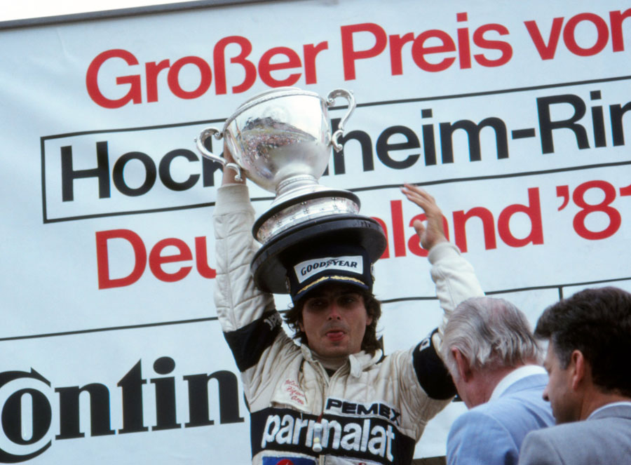 Nelson Piquet celebrates his victory on the podium