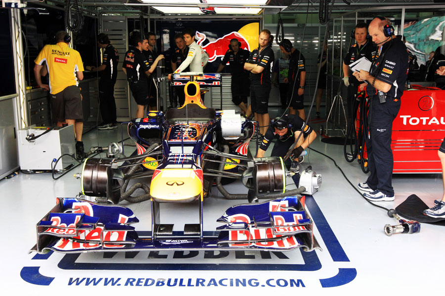 Adrian Newey inspects the RB8 in the Red Bull garage