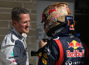 Michael Schumacher talks to Sebastian Vettel in parc ferme