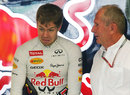 Sebastian Vettel chats with Helmut Marko in the Red Bull garage