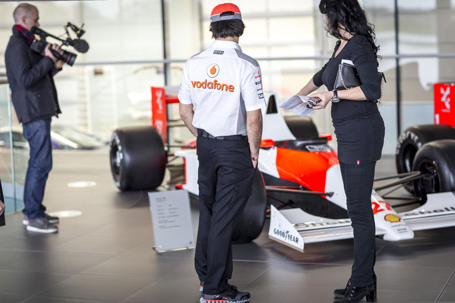 Sergio Perez takes a look at the cars on display on his first day at McLaren