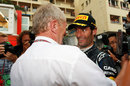 Mark Webber celebrates his victory with Helmut Marko