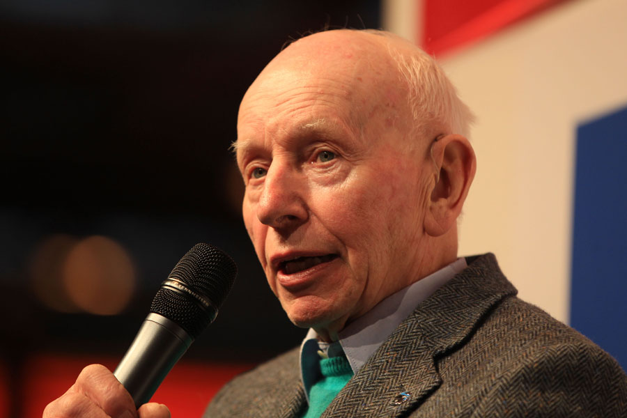 John Surtees addresses the crowd at the Autosport show