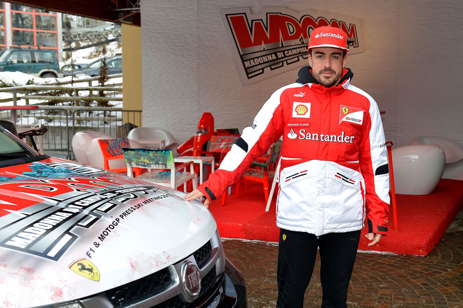 Fernando Alonso poses at Ferrari's Wrooom event